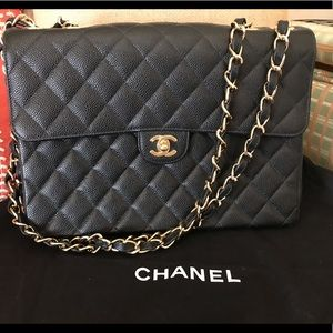Black quilted Chanel with flap close.